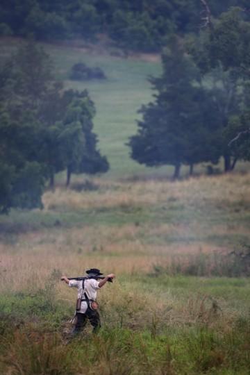 A Civil War re-enactor walks at dusk during a three-day Battle of Gettysburg re-enactment on June 29, 2013 in Gettysburg, Pennsylvania. (John Moore/Getty Images)