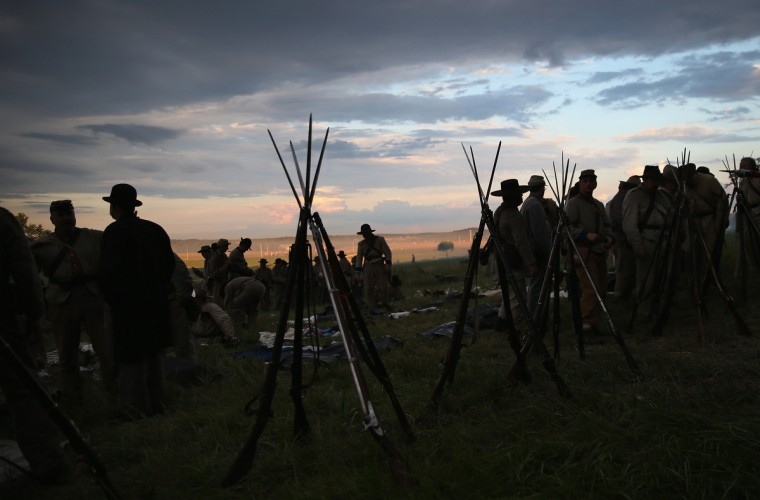 Civil War re-enactors from Hood's Texas Brigade prepare for an evening attack on Union forces during a three-day Battle of Gettysburg re-enactment on June 29, 2013 in Gettysburg, Pennsylvania. (John Moore/Getty Images)