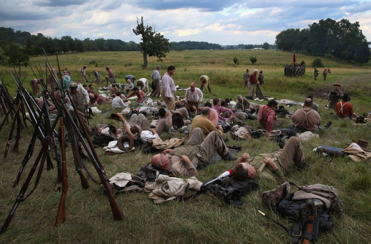 Civil War re-enactors from Hood's Texas Brigade rest before launching an evening battle as part of a three-day Battle of Gettysburg re-enactment on June 29, 2013 in Gettysburg, Pennsylvania. (John Moore/Getty Images)