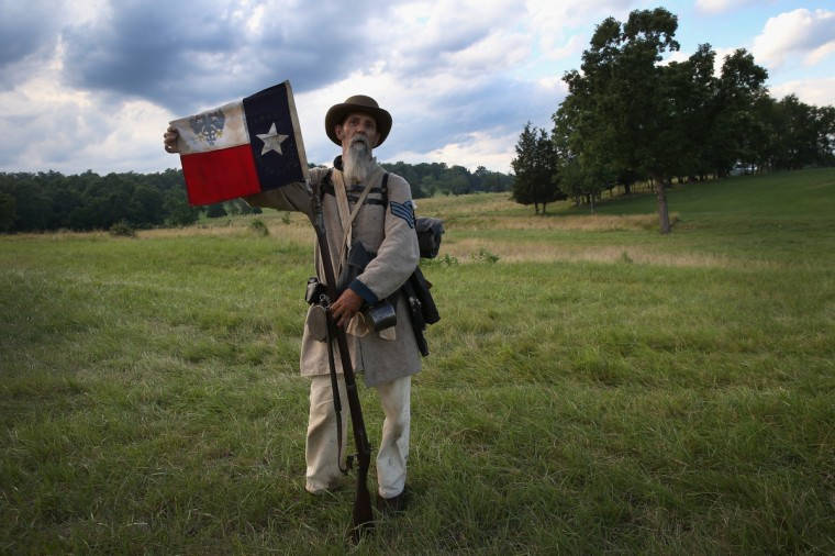Civil War re-enactor Randy Whitaker from Hood's Texas Brigade displays the Texas flag during a three-day Battle of Gettysburg re-enactment on June 29, 2013 in Gettysburg, Pennsylvania. (John Moore/Getty Images)