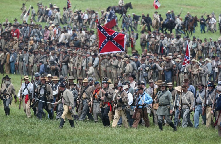 Confederate Civil War re-enactors march towards Union lines during Pickett's Charge on the last day of a Battle of Gettysburg re-enactment on June 30, 2013 in Gettysburg, Pennsylvania. (John Moore/Getty Images)