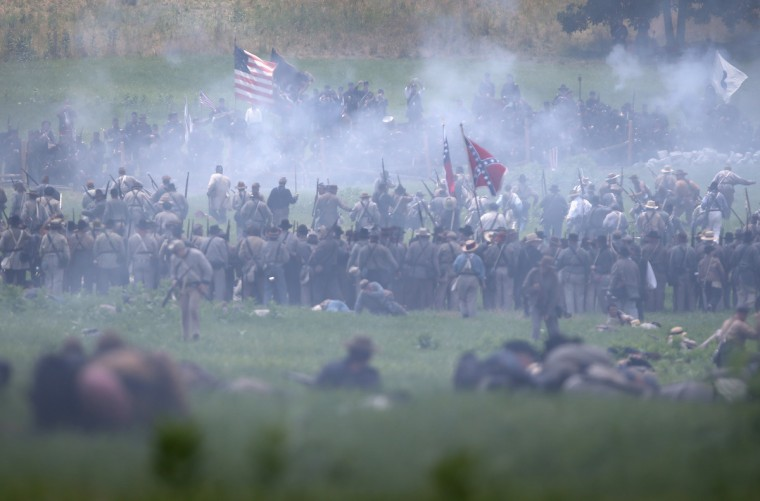 American Civil War re-enactors clash during Pickett's Charge on the last day of a Battle of Gettysburg re-enactment on June 30, 2013 in Gettysburg, Pennsylvania. (John Moore/Getty Images)