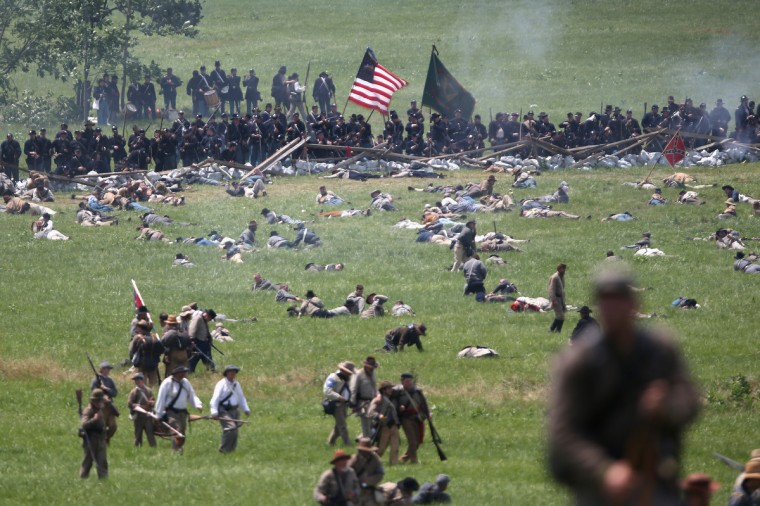 Confederate Civil War re-enactors litter the battlefield at the end of Pickett's Charge on the last day of a Battle of Gettysburg re-enactment on June 30, 2013 in Gettysburg, Pennsylvania. (John Moore/Getty Images)