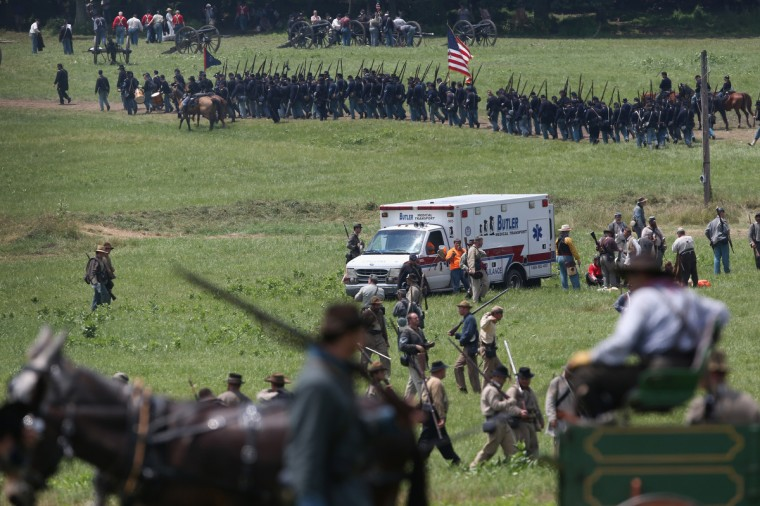 An ambulance departs at the end of Pickett's Charge on the last day of a Battle of Gettysburg re-enactment on June 30, 2013 in Gettysburg, Pennsylvania. Several people were taken away from the event due to heat exhaustion. (John Moore/Getty Images)
