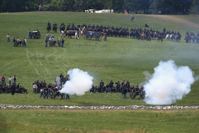 Union Civil War re-enactors fire a cannon towards Confederate positions during Pickett's Charge on the last day of a Battle of Gettysburg re-enactment on June 30, 2013 in Gettysburg, Pennsylvania. (John Moore/Getty Images)