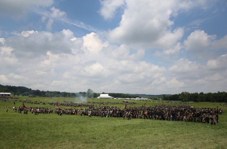 Confederate Civil War re-enactors march towards Union positions during Pickett's Charge on the last day of a Battle of Gettysburg re-enactment on June 30, 2013 in Gettysburg, Pennsylvania. (John Moore/Getty Images)