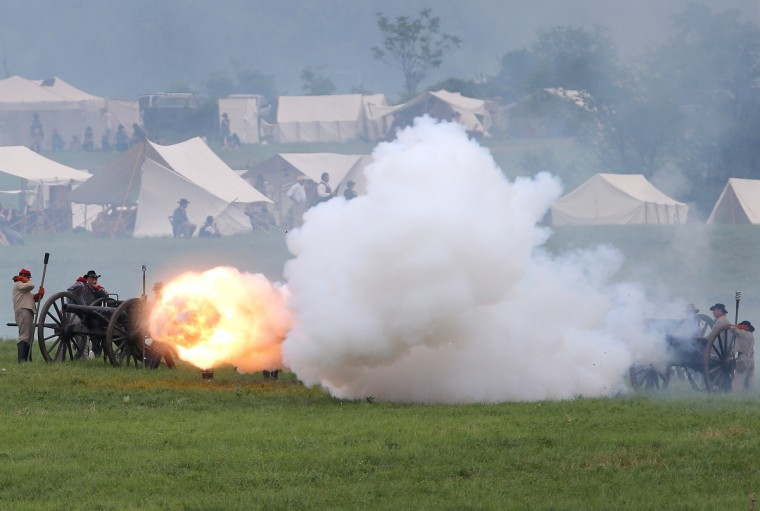 Confederate Civil War re-enactors fire cannon towards Union positions ahead of Pickett's Charge on the last day of a Battle of Gettysburg re-enactment on June 30, 2013 in Gettysburg, Pennsylvania. (John Moore/Getty Images)