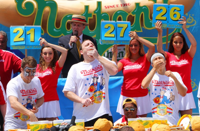 (L to R) Tim Janus, Joey Chestnut, and Matt Stonie compete in the Nathan's Famous Fourth of July Hot Dog Eating Contest at Nathan's Famous in Coney Island on July 4, 2013 in the Brooklyn borough of New York City. Chestnut, of San Jose, California, ate 69 hotdogs in ten minutes to win his seventh straight title. (Monika Graff/Getty Images)
