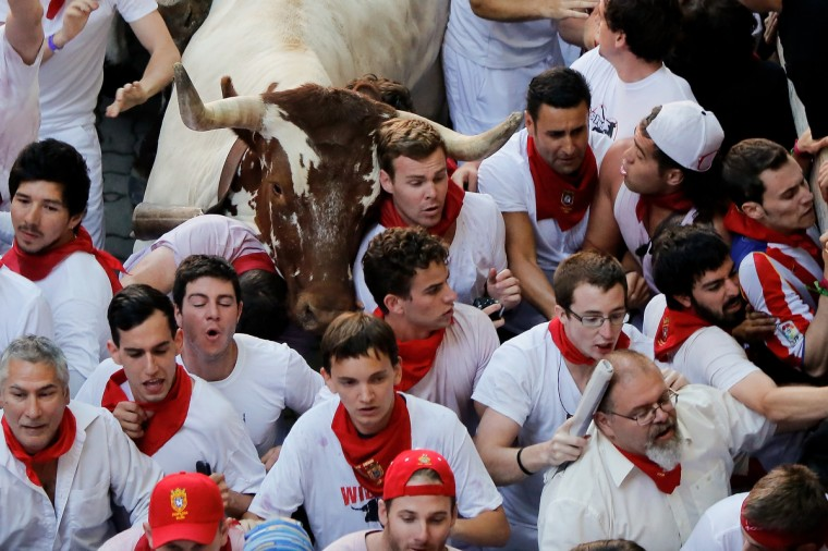 Steers make their way through a crowd of runners after the Alcurrucen's ranch fighting bulls entered the bullring during the second day of the San Fermin Running Of The Bulls festival in Pamplona, Spain. (Pablo Blazquez Dominguez/Getty Images)