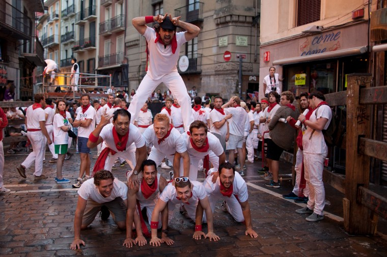 Revellers form a human tower to pose for a picture in the early hours ahead of Dolores Aguirre's ranch fighting bulls running on the third day of the San Fermin Running Of The Bulls festival in Pamplona, Spain. (Pablo Blazquez Dominguez/Getty Images)