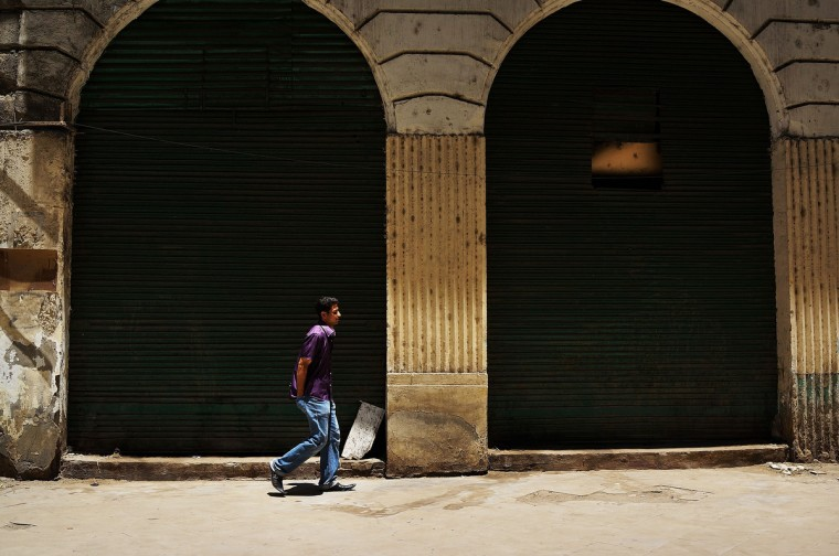 A man walks through a closed market on the first day of Ramadan, the sacred holy month for Muslims where many will fast from sun-up to sun-down on July 10, 2013 in Cairo, Egypt. Egypt continues to be in a state of political paralysis following the ousting of Muslim Brotherhood leader Mohamed Morsi by the military. Adly Mansour, chief justice of the Supreme Constitutional Court, was sworn in as the interim head of state in a ceremony in Cairo on the morning of July 4. (Spencer Platt/Getty Images)