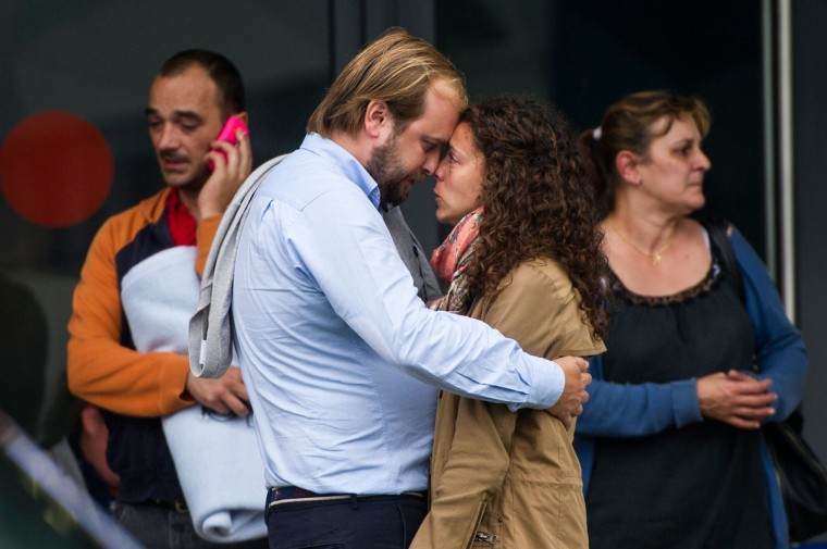 Relatives of passengers involved in the train crash comfort each other as they wait for news at the Cersia Building on July 25, 2013 in Santiago de Compostela, Spain. The crash occurred on Wednesday at 8.40pm as the train approached the north-western Spanish city of Santiago de Compostela, with 247 passengers on board. At least 77 people have died and a further 131 have been reported injured. The crash occurred on the eve of Santiago de Compostela's main religious festival, which has been cancelled by the City's officials. (David Ramos/Getty Images)