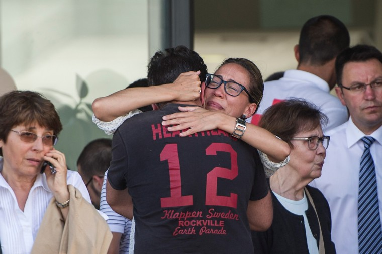 Relatives of passengers involved in the train crash wait for news at the Cersia Building on July 25, 2013 in Santiago de Compostela, Spain. The crash occurred as the train approached the north-western Spanish city of Santiago de Compostela at 8.40pm on July 24th, at least 77 people have died and a further 131 reported injured. The crash occured on the eve of the Santiago de Compostela Festivities. (David Ramos/Getty Images)