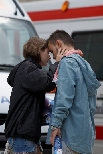 A couple embrace as they leave the temporary morgue at Multiusos Fontes do Sar Sport Center after a train crash killing at least 78 people on July 26, 2013 in Santiago de Compostela, Spain. The high speed train crashed after it derailed on a bend as it approached the north-western Spanish city of Santiago de Compostela at 8.40pm on July 24th. At least 78 people have died and a further 131 are reported injured. The crash occured on the eve of the Santiago de Compostela Festivities. (Pablo Blazquez Dominguez/Getty Images)