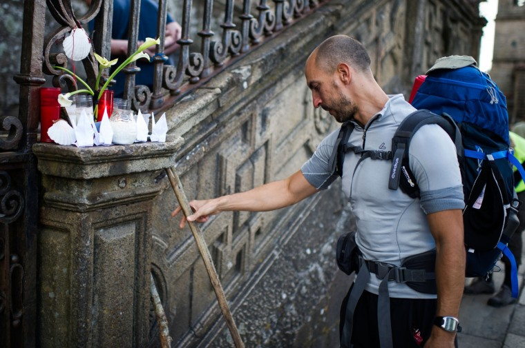 A pilgrim leaves his cane next to candles in memory of the train crash victims at the Cathedral of Santiago , on July 26, 2013 in Santiago de Compostela, Spain. The high speed train crashed after it derailed on a bend as it approached the north-western Spanish city of Santiago de Compostela at 8.40pm on July 24th. At least 78 people have died and a further 131 are reported injured. The crash occured on the eve of the Santiago de Compostela Festivities. (David Ramos/Getty Images)