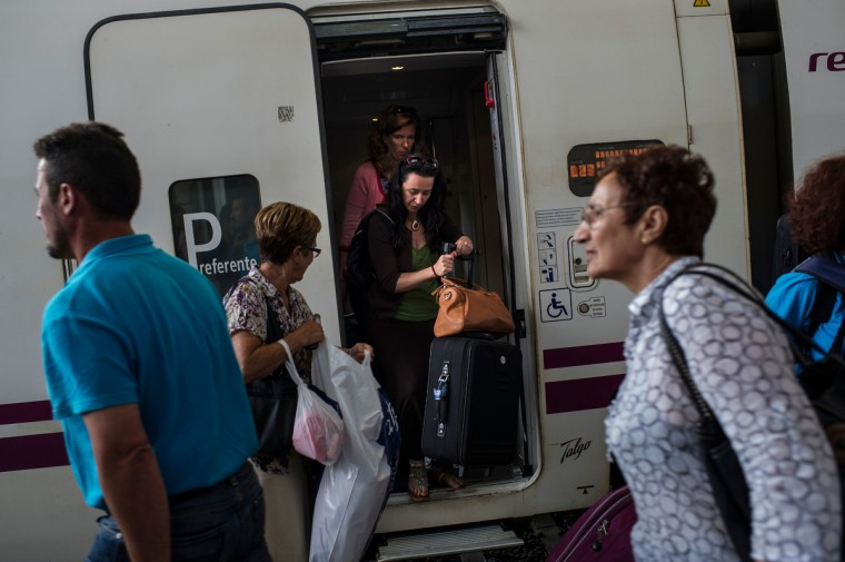 Passengers disembark the first train traveling from Madrid to Coruna get off at the Santiago de Compostela train station , on July 26, 2013 in Santiago de Compostela, Spain. The high speed train crashed after it derailed on a bend as it approached the north-western Spanish city of Santiago de Compostela at 8.40pm on July 24th. At least 78 people have died and a further 131 are reported injured. The crash occured on the eve of the Santiago de Compostela Festivities.(David Ramos/Getty Images)