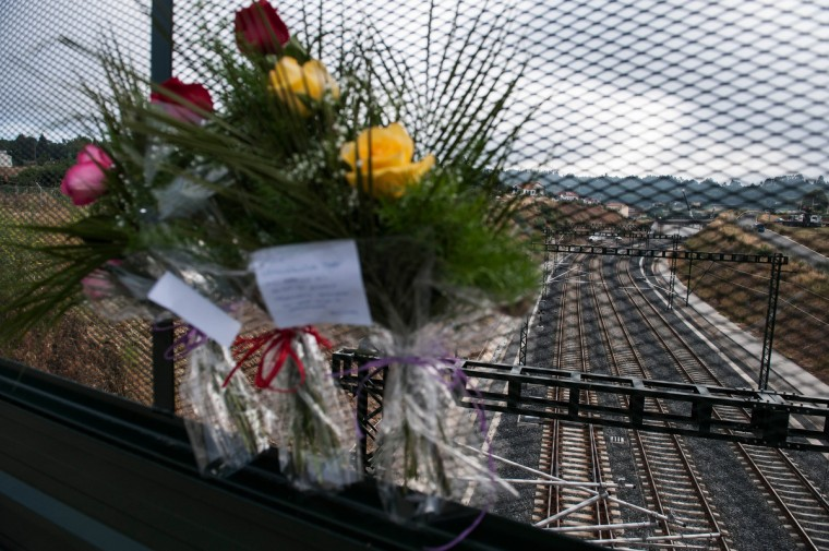 Flowers are left at the scene of a train crash which killed 78 people are seen on a bridge over the track on July 26, 2013 in Santiago de Compostela, Spain. The crash occurred as the train approached the north-western Spanish city of Santiago de Compostela at 8.40pm on July 24th, at least 78 people have died and a further 131 reported injured. The crash occured on the eve of the Santiago de Compostela Festivities. (David Ramos/Getty Images)