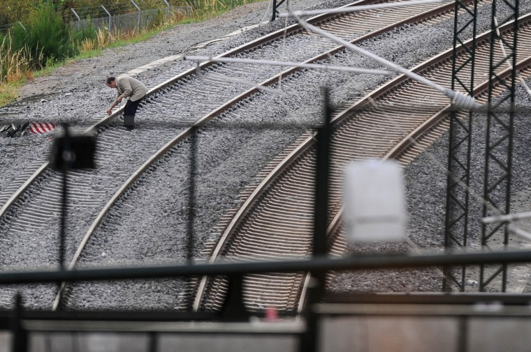 A man inspects the rail at the train crash site on July 26, 2013 in Santiago de Compostela, Spain. The crash occurred as the train approached the north-western Spanish city of Santiago de Compostela at 8.40pm on July 24th, at least 78 people have died and a further 131 reported injured. The crash occured on the eve of the Santiago de Compostela Festivities. (David Ramos/Getty Images)