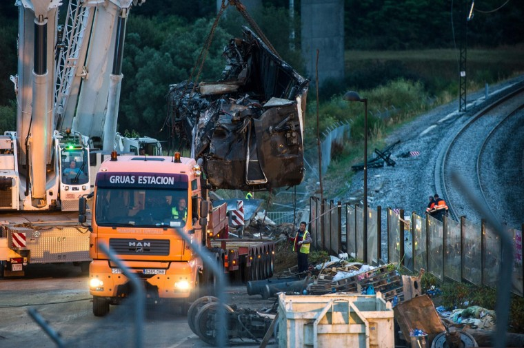 A carriage of the crashed train which killed 78 people is lifted onto a truck on July 26, 2013 in Santiago de Compostela, Spain. The crash occurred as the train approached the north-western Spanish city of Santiago de Compostela at 8.40pm on July 24th, at least 78 people have died and a further 131 reported injured. The crash occured on the eve of the Santiago de Compostela Festivities. (David Ramos/Getty Images)