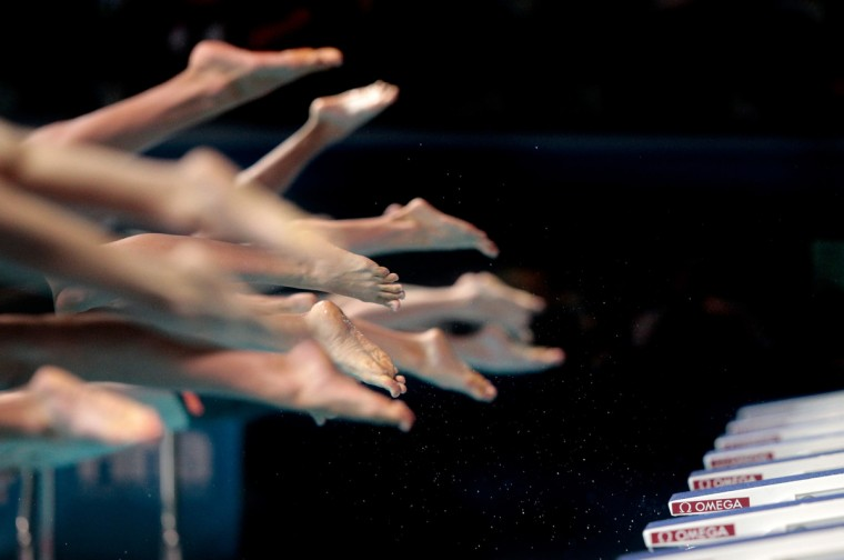 Athletes compete during the swimming events on day ten of the 15th FINA World Championships at Palau Sant Jordi in Barcelona, Spain. (Adam Pretty/Getty Images)