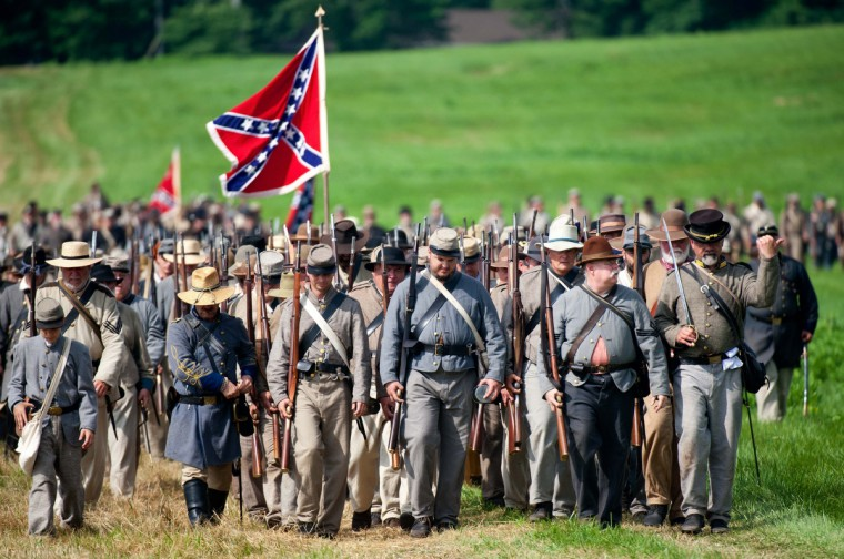 Confederate troops march into position during a re-enactment of the Battle of Gettysburg on June 28, 2013 at the start of the 150th Gettysburg celebration and re-enactments in Gettysburg, Pennsylvania. (Karen Bleier/Getty Images)