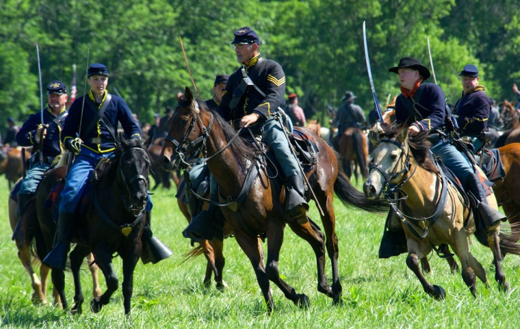 Union forces charge during a re-enactment of the Battle of Gettysburg on June 29, 2013, at the start of the 150th Gettysburg celebration in Gettysburg, Pennsylvania. (Karen Bleier/Getty Images)