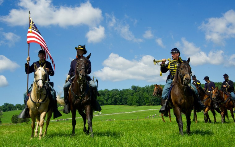 Union cavalry troops parade in review following battle during a re-enactment of the Battle of Gettysburg on June 29, 2013, at the start of the 150th Gettysburg celebration in Gettysburg, Pennsylvania. (Karen Bleier/Getty Images)