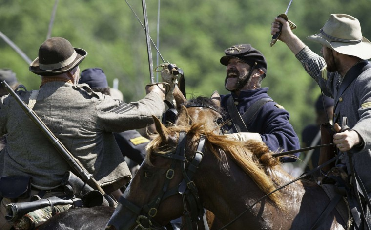 Confederate, and Union, cavalry engage with sabres during a re-enactment of the Battle of Gettysburg on June 29, 2013, at the start of the 150th Gettysburg celebration in Gettysburg, Pennsylvania. (Karen Bleier/Getty Images)