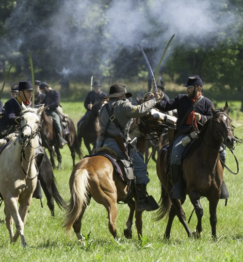 Confederate and Union cavalry engage with sabres during a re-enactment of the Battle of Gettysburg on June 29, 2013, at the start of the 150th Gettysburg celebration in Gettysburg, Pennsylvania. (Karen Bleier/Getty Images)