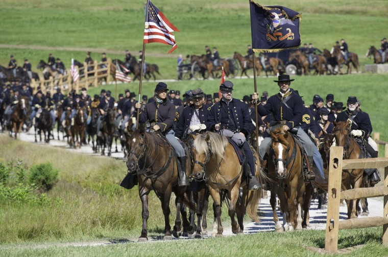 Union Cavalry arrives at the battlefield during a re-enactment of the Battle of Gettysburg on June 29, 2013, at the start of the 150th Gettysburg celebration in Gettysburg, Pennsylvania. (Karen Bleier/Getty Images)