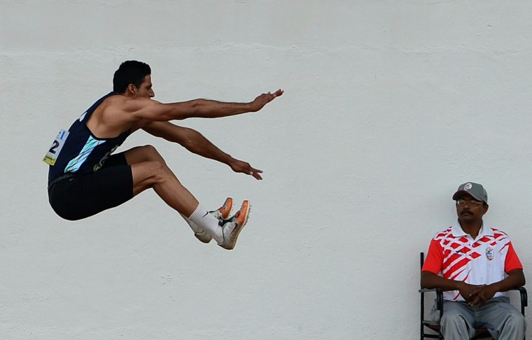 Indian athlete Bharatinder Singh takes part in the long jump section of the Decathlon competition on the first day of the five day Asian Athletics Championship 2013 at The Shiv Chhtrapati Stadium in Pun.(Manjunath Kiran/AFP/Getty Images)