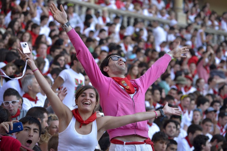 People attend the second bull run of the San Fermin Festival in Pamplona, northern Spain. (Pedro Armestre/Getty images)