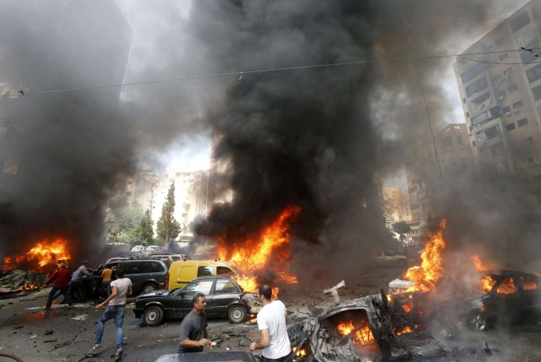 Civilians gather at the of an explosion in Beirut's southern suburb neighborhood of Bir al-Abed. A car bomb rocked Beirut's southern suburbs, stronghold of Lebanon's Shiite Hezbollah movement, wounding 15 people, television reports and a military source said. (Getty Images)