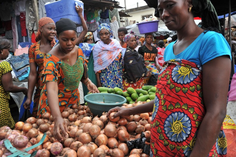 A woman sells onions in the market of Abobo, a suburb of Abidjan on July 9, 2013 on the first day of the Muslim holy month of Ramadan in Ivory Coast. The holy month of Ramadan, during which Muslims fast from dawn to dusk, begins with the sighting of the new moon, which varies from country to country. (Issouf Sanogo/Getty Images)