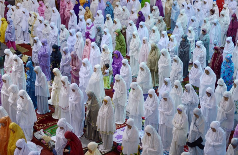 Indonesian Muslim women hold prayers on the first night of the holy month of Ramadan at the Istiqlal mosque in Jakarta. Islam's holy month of Ramadan is celebrated by Muslims worldwide marked by fasting, abstaining from foods, sex and smoking from dawn to dusk for soul cleansing and strengthening the spiritual bond between them and the Almighty. (Adek Berry/Getty Images)