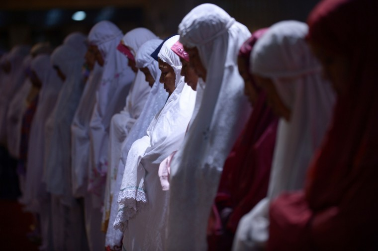 Indonesian Muslim women hold prayers on the first night of the holy month of Ramadan at the Istiqlal mosque in Jakarta on July 9, 2013. Islam's holy month of Ramadan is celebrated by Muslims worldwide marked by fasting, abstaining from foods, sex and smoking from dawn to dusk for soul cleansing and strengthening the spiritual bond between them and the Almighty. (Adek Berry/Getty Images)