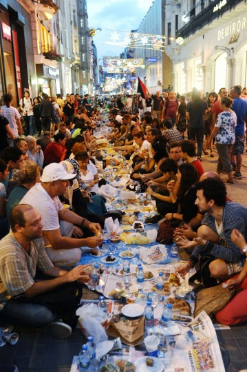 Turkish anti government protesters gather as they break their first day of fasting for the Muslim holy month of Ramadan on Istiklal street, the main shopping corridor, on July 9, 2013 in Istanbul. During the month devout Muslims must abstain from food, drink and sex from dawn until sunset, when they break the fast with the meal known as Iftar. (Bulent Kilic/Getty Images)