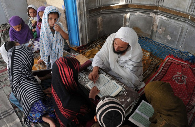 Afghan children read and memorize the Koran at a mosque in Jalalabad on July 10, 2013, during the Muslim holy month of Ramadan. Muslims all over the world are supposed to go without food, drink and smoking from sunrise to sunset during the holy month of Ramadan in order to purify themselves and concentrate their mind on Islamic teachings. (Noorullah Shirzada/Getty Images)