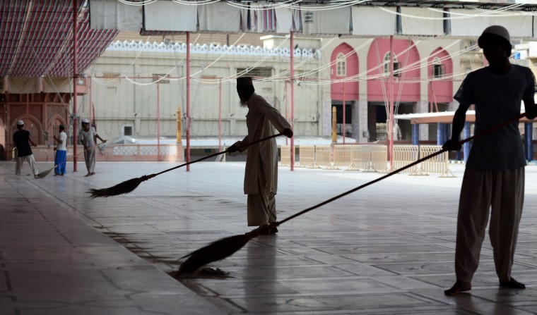 Pakistani Muslim men clean the floor of a mosque on the eve of Ramadan in Karachi on July 10, 2013. Islam's holy month of Ramadan is celebrated by Muslims worldwide marked by fasting, abstaining from foods, sex and smoking from dawn to dusk for soul cleansing and strengthening the spiritual bond between them and the Almighty. (Rizwan Tabassum/Getty Images)