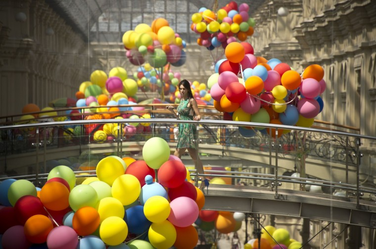 A woman crosses a bridge at GUM, one of the oldest department stores in central Moscow. (Natalia Kolesnikova/Getty Images)