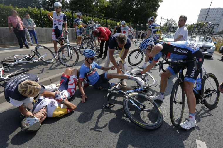New Zealand's Gregory Henderson (L) lies on the ground after falling during the 218 km twelfth stage of the 100th edition of the Tour de France cycling race. (Pascal Guyot/Getty Images)