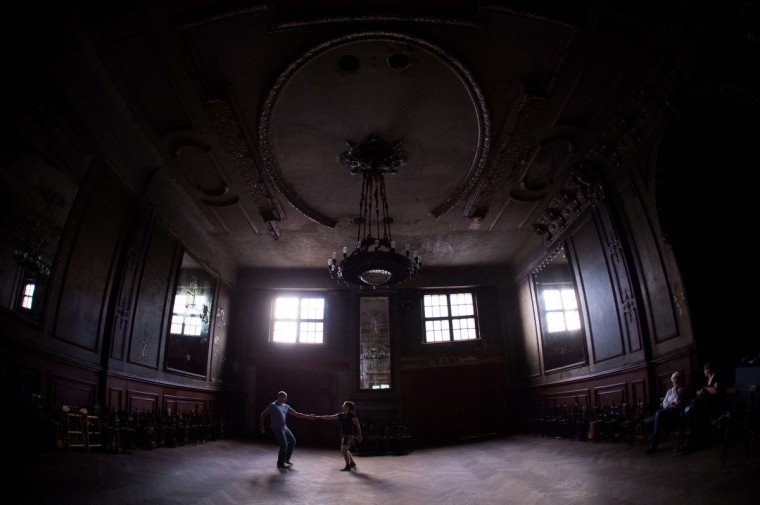 People dance during a lesson in the Spiegelsaal (hall of mirrors) at Claerchens Ballhaus in Berlin. (Johannes Eisele/Getty Images)