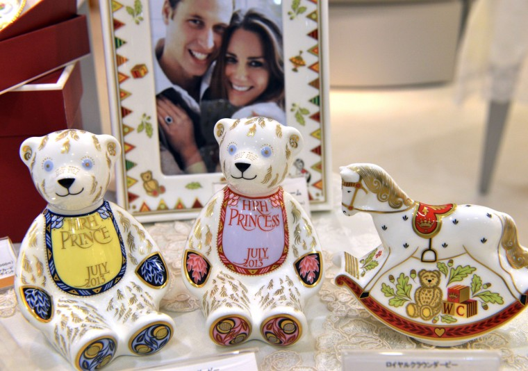 Japan's Takashimaya department store displays samples of commemorative figures and table wears for Britain's expected royal baby at a shop of British porcelain maker Royal Crown Derby at Takashimaya's main store in Tokyo. One of blue or red teddy bears will be delivered to customers in September with the royal baby's name on its apron. Customers will have blue one if the royal baby is a boy, while red one will be delivered if the baby is a girl. (Yoshikazu Tsuno/Getty images)