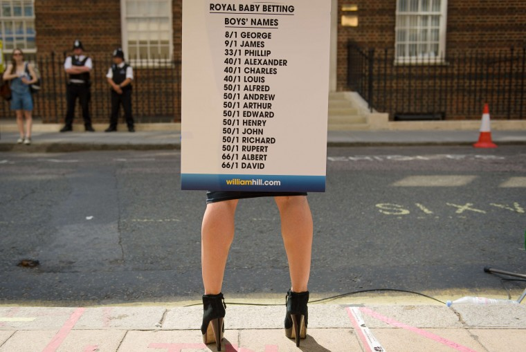 "A bookmaker presents the latest odds on boys names outside the Lindo Wing of St Mary's Hospital in London where Prince William and his wife Catherine's baby is expected to be born. Britain's Prince Charles joked Monday that his son Prince William's baby was ""hopefully"" on the way, but wife Camilla went further, saying it could arrive ""by the end of the week"". (Leon Neal/Getty images)"