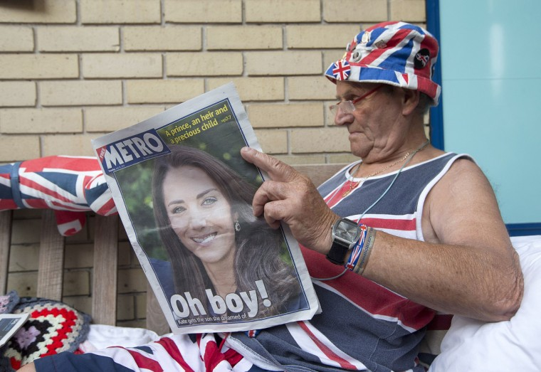 Royal Supporter Terry Hutt reads a newspaper announcing the birth of the newest member of Britain's royal family outside St Mary's Hospital in London. Britain's new baby prince follows his father and late grandmother by being born under the zodiac sign of Cancer, suggesting he will be a strong leader, according to astrologists. (Justin Tallis/Getty images)