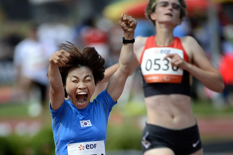 Korean athlete Min Jae Jeon celebrates as she wins the women's 200m T36 final of the IPC Athletics World Championships of Lyon on July 23, 2013 at the Rhone Stadium in Venissieux, near Lyon. (Jeff Pachoud/Getty images)