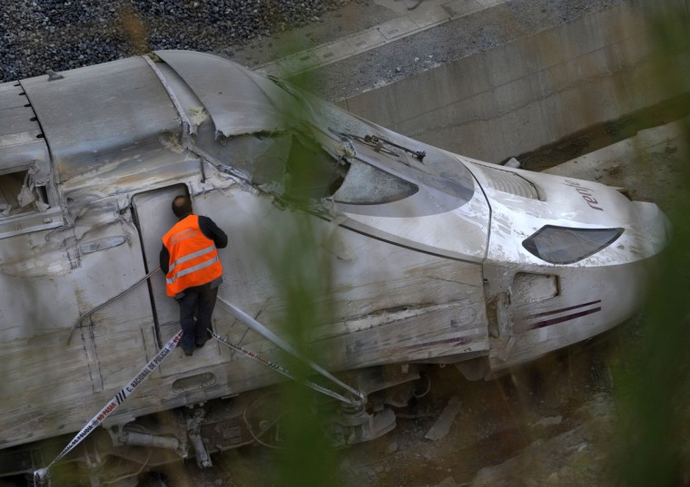 A member of the road security department checks inside the locomotive at the site of a train accident near the city of Santiago de Compostela on July 25, 2013. A train hurtled off the tracks on July 24, 2013 in northwest Spain killing at least 77 passengers and injuring more than 140, an official said today, the country's deadliest rail disaster in more than 40 years. (Miguel Riopa/Getty Images)