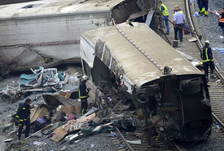 Rescuers checks a train's car at the site of a train accident near the city of Santiago de Compostela on July 25, 2013. A train hurtled off the tracks on July 24, 2013 in northwest Spain killing at least 77 passengers and injuring more than 140, an official said today, the country's deadliest rail disaster in more than 40 years. (Miguel Riopa/Getty Images)