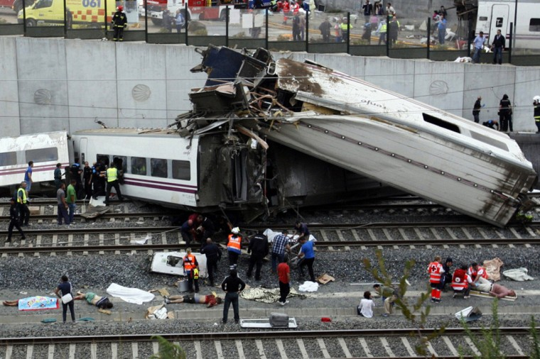 A picture taken on July 24, 2013 shows derailed cars at the site of a train accident near the city of Santiago de Compostela. Between 45 and 50 people died when a train derailed in Galicia in northwestern Spain today, the president of the regional government of Galicia said. The train which carried 238 passengers originated in Madrid and was bound for the northwestern town of Ferrol. (Oscar Corral/Getty Images)