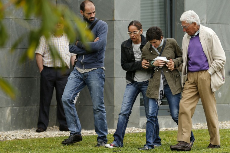 Relatives of the victims of a train accident react outside the Cersia building, where they are attended by psychologists from the Red Cross in Santiago de Compostela on July 25, 2013. A train hurtled off the tracks on July 24, 2013 in northwest Spain killing at least 77 passengers and injuring more than 140, an official said today, the country's deadliest rail disaster in more than 40 years. (Cesar Manso/Getty images)